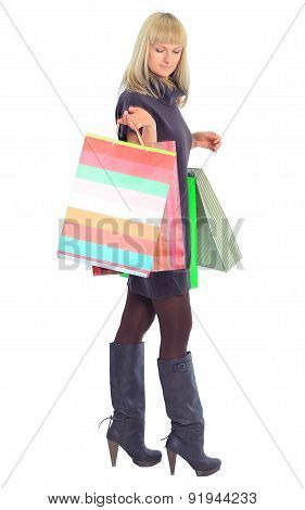 smiling young female with shopping bags