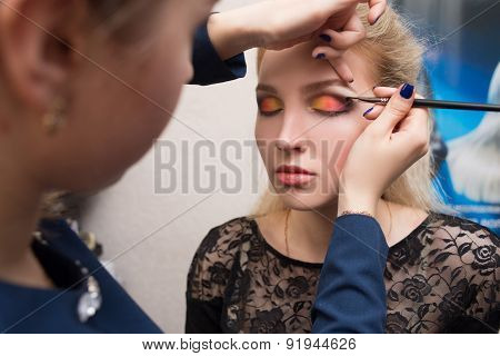 girl applied make-up on her eyes