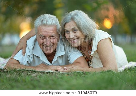 Elderly couple smilling together