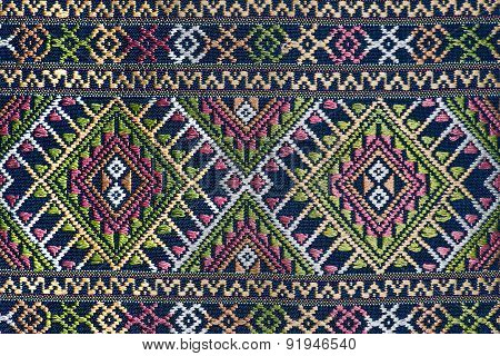 Colorful thai silk handcraft peruvian style rug surface close up More this motif & more textiles per