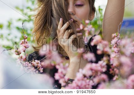 Portrait Of Young Beautiful Girl In Flowers