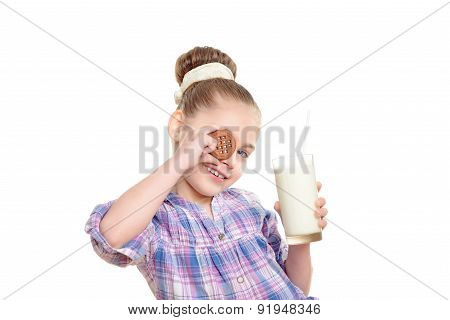 Small girl with milk and cookie