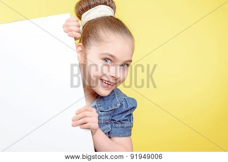 Small girl holding a copy space