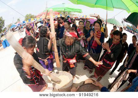 Phutai Minority Woman Pounding Rice.