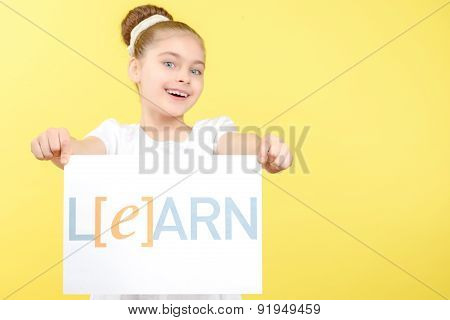 Small girl with copy space in her hands
