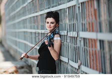 girl posing with violin