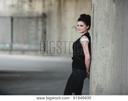 girl posing near the wall