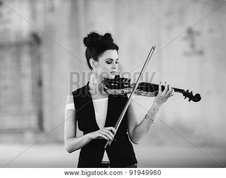 beautiful girl with violin posing