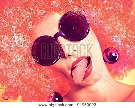 Glamorous freckled girl in fashionable sunglasses with afro hairstyle