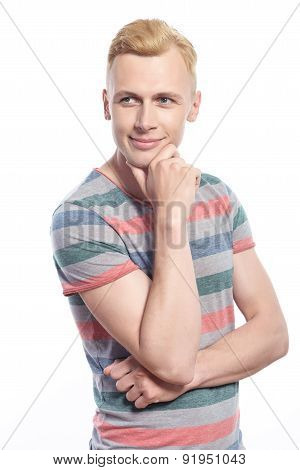 Young handsome man holding hand near chin