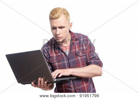 Young handsome man standing with lap top