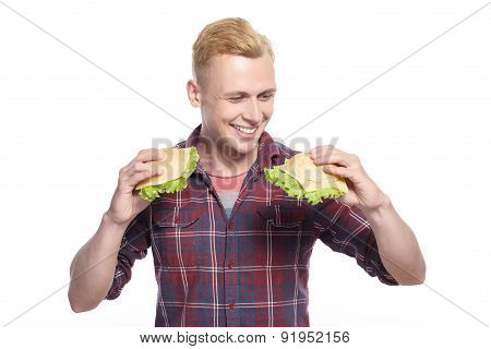 Young handsome man choosing sandwich
