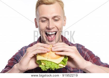 Man taking bite of sandwich