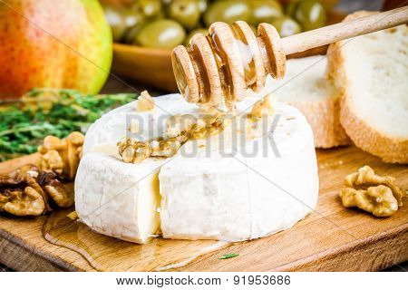 Camembert Cheese With Walnuts And  Honey  Closeup