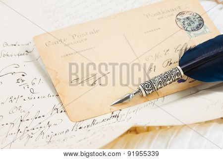 old postcard with feather pen