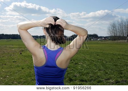 Backside Of Woman With Ponytail Outdoors