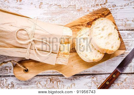 French Baguette Sliced On Cutting Board
