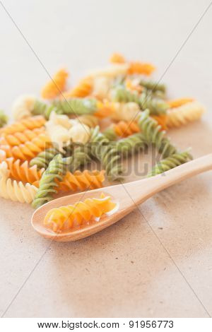Raw Fusilli Pasta With Wooden Spoon