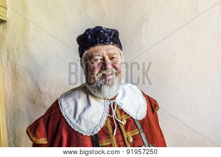Old Man Dressed In Medieval Clothes In Rothenburg