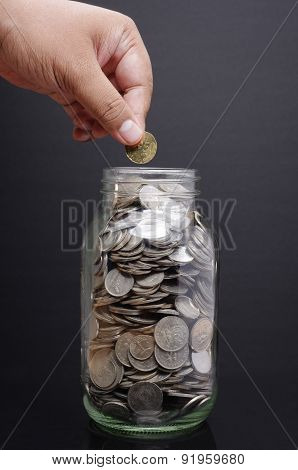 Glass Jar, Hand with Coins