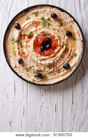 Fresh Hummus With Olives And Tomatoes. Vertical Top View
