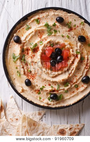 Hummus With Olives, Tomatoes And Herbs Vertical Top View