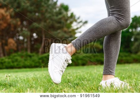 Close up of woman legs in park