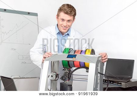 Scientist working with three-dimensional  printer