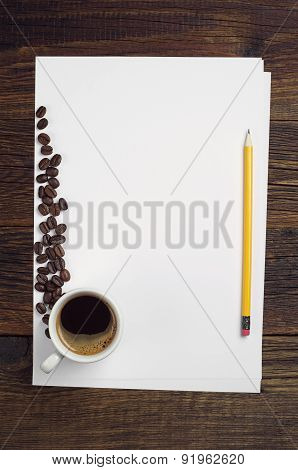 Blank Sheet Of Paper And Coffee