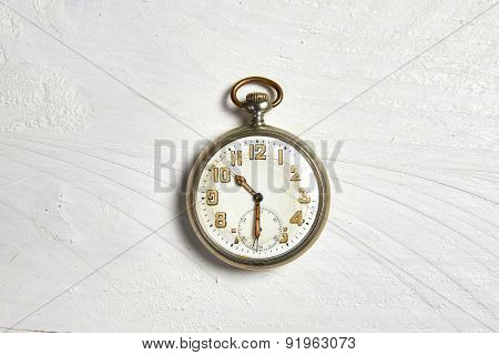 Old Pocket Watch On A White Wooden Table