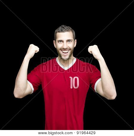 Soccer player on red uniform on black background