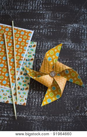 Paper Homemade Pinwheel On A Brown Wooden Surface, Vintage Style