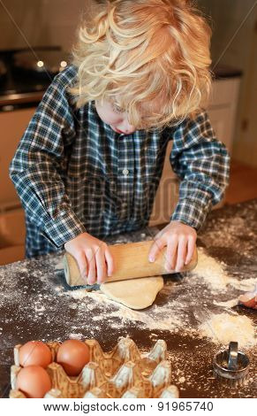 Little Boy Rolling Out Pastry
