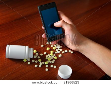 Person With Cellphone And The Pills
