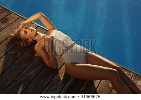 Beautiful Sexy Tanned Girl With Long Blond Hair In Elegant Swimsuit