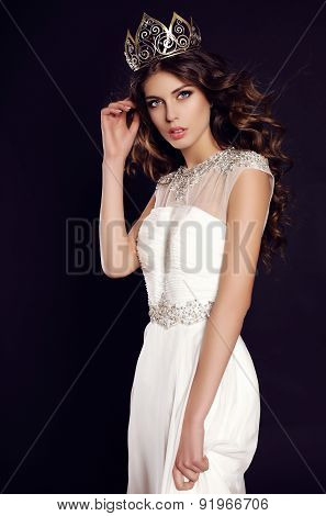 Woman With Dark Hair In Elegant Dress With Luxurious Crown