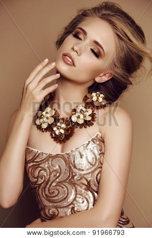 Young Girl With Blond Hair And Bright Makeup With Accessories