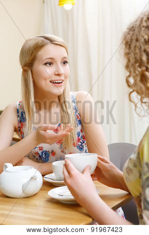 Two women having conversation in cafe