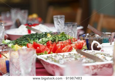 Sliced Tomatoes On Holiday Table