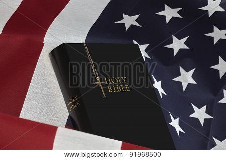 Bible And Gold Cross On American Usa  Flag