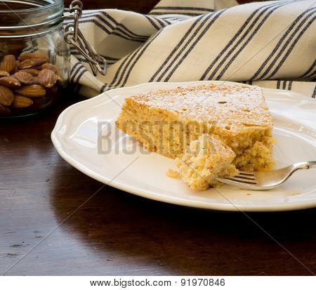 Lemon Almond Cake Slice With Fork On White Plate