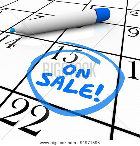 On Sale words written by blue marker on a calendar day or date to illustrate when new products or merchandise are available to buy