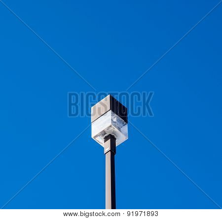 Square Outdoor Light On Post On Blue Sky.