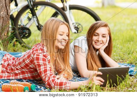 Two girls on a picnic with bikes