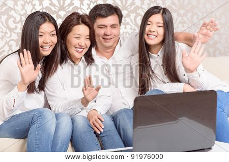 Family sitting on skype together