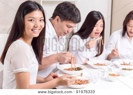 Asian family having lunch together