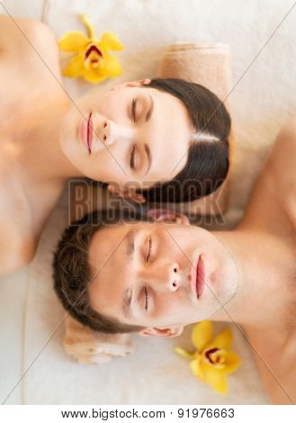 picture of couple in spa salon lying on the massage desks