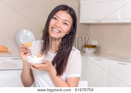 Happy Asian girl posing with food