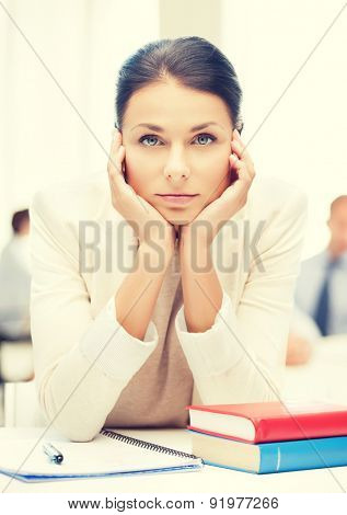 business and education concept - stressed businesswoman in office