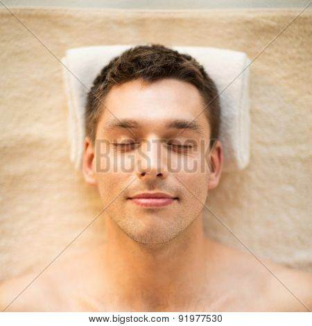 healthcare, spa and beauty concept - close up of man face in spa salon
